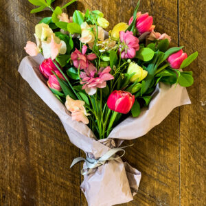 large wrapped flower bouquet with seasonal spring flowers